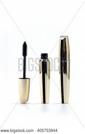 Mascara Golden Bottle And Brush. Fashionable Cosmetics Makeup For Eyes, Black Mascara Wand And Tube