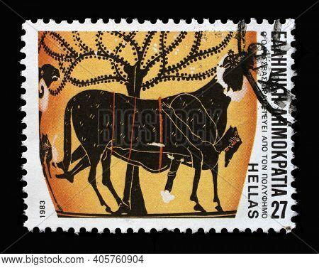 ZAGREB, CROATIA - AUGUST 29, 2014: Stamp printed by Greece shows Homer's Epics - Ulysses escaping from Polyphemus' cave, circa 1983
