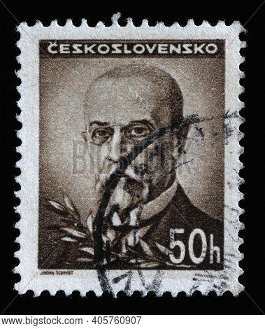 ZAGREB, CROATIA - SEPTEMBER 03, 2014: Stamp printed in Czechoslovakia shows first President of Czechoslovakia - Thomas Garrigue Masaryk, circa 1945