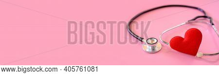 Valentines Day And Sweetest Day Concept. Stethoscope With Red Heart On Pink Background. Love Symbol