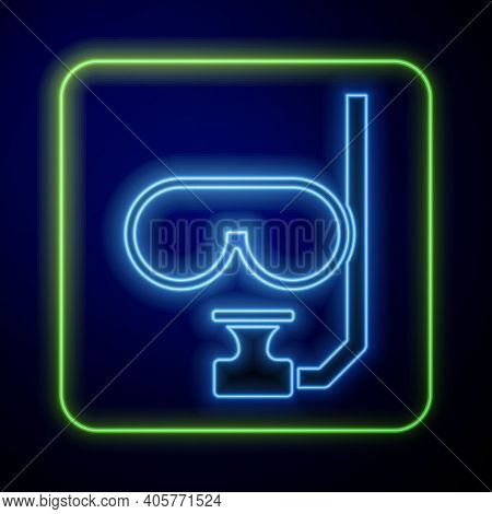 Glowing Neon Diving Mask And Snorkel Icon Isolated On Blue Background. Extreme Sport. Diving Underwa