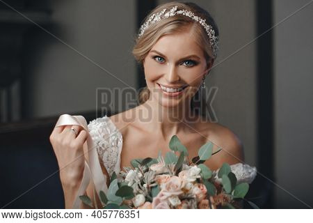 Pretty Bride With Wedding Makeup, Fashion Jewelry. Beautiful Woman Posing In White Wedding Dress. We