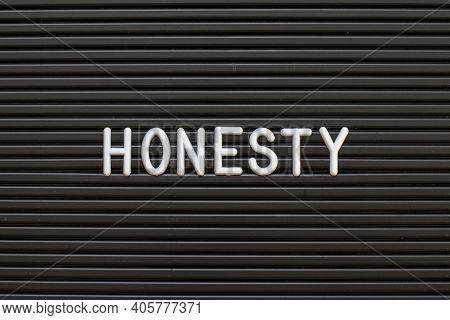 White Alphabet In Word Honesty On Black Color Felt Letter Board Background