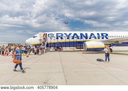 Vienna, Austria - May 09, 2019: Passengers Boarding Ryanair Flight From Santiago Spain To Milano Ita