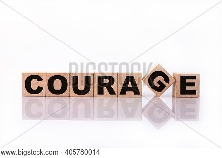 Courage Word, Text, Written On Wooden Cubes, Building Blocks, Over White Background With Reflection.