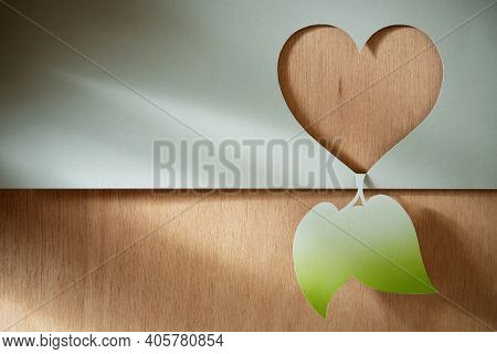 Nature Care, Ecology And Environmental Preservation Concept. Paper Cut As Heart And Green Leaf Shape
