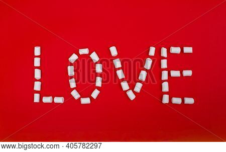 Text Made By White Marshmallows On Red Background