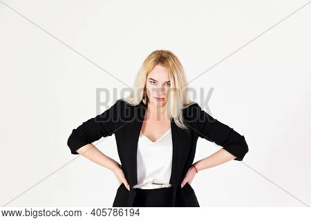 Studio Portrait Of Blonde Girl Isolated On White Background. Reference Photo Of An Arrogant Girl For