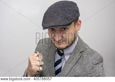 Portrait Of A Man In A Boxing Stance With Brass Knuckles, Causing Serious Bodily Harm, A Threat To L