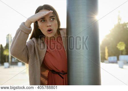 Jealous Woman Spying On Ex Boyfriend Outdoors
