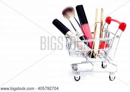 Shopping Cart With Cosmetics On White Background