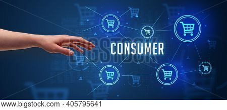 Close-Up of cropped hand pointing at CONSUMER inscription, online shopping concept