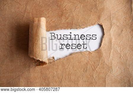 Torn Piece Of Scroll Revealing Business Reset
