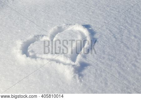 Heart Is Drawn In Snowy Glade. Background For Decoration For Holiday Of Valentine\'s Day. Cold Heart