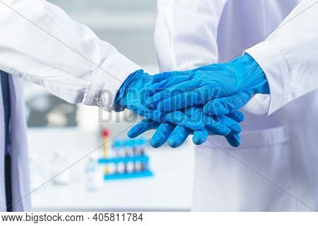 Teamwork In Hospital Or Laboratory For Success Work And Trust In Team Concept. Group Of Scientist Or