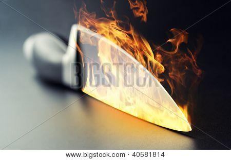 Closeup of burning professional kitchen knife