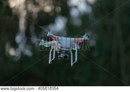 Great Malvern, United Kingdom, 27th December, 2020: Uav Remote Control White Drone Hovers With Plain
