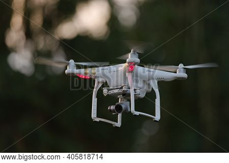 Great Malvern, United Kingdom, 27th December, 2020: Propellers Spinning As This Quadcopter Drone Hov