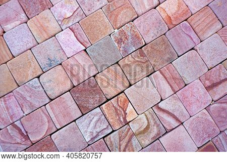 The Texture Of The Paved Tile On The Bottom Of The Street. Natural Brick Squared Stone Floor Backgro