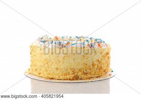 Closeup Of Vanilla Birthday Cake On A White Background