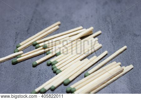 Matches In Box, Dark Background. Macro Photography. Close-up Shot. Matches In Open Match-box On Cart