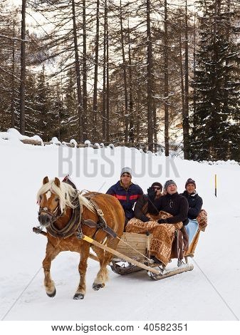 Tourists Enjoy A Horse-drawn Sleigh Ride