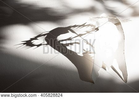 Face Of Jesus Made With Shadow And Head Burning In Light As Easter Resurrection Symbol, Savior Of Ma