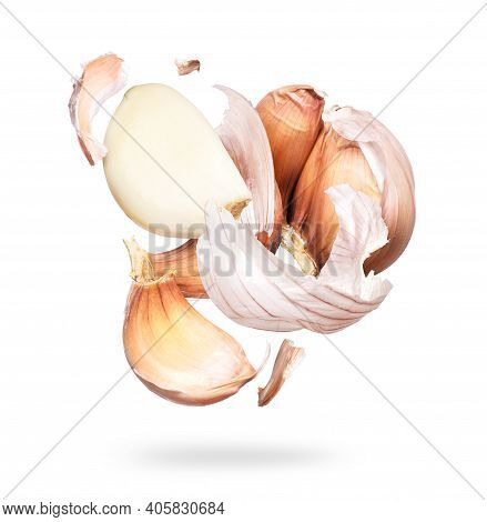 Garlic Unfolds In The Air Close-up On A White Background