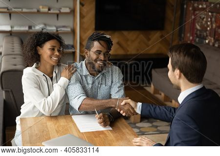 Grateful Black Family Couple Handshake With Insurer Before Signing Contract