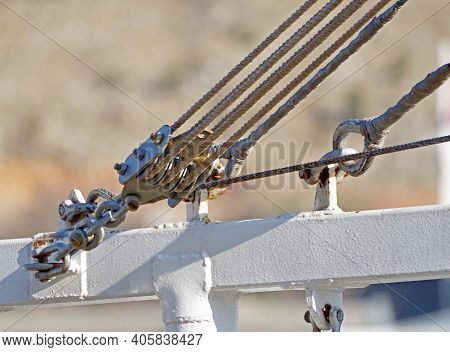 Metallic Pulley Block And Ropes On The Old Fishing Ship