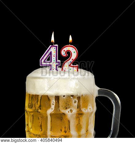 Number 42 Candle In Beer Mug For Birthday Celebration Isolated On Black