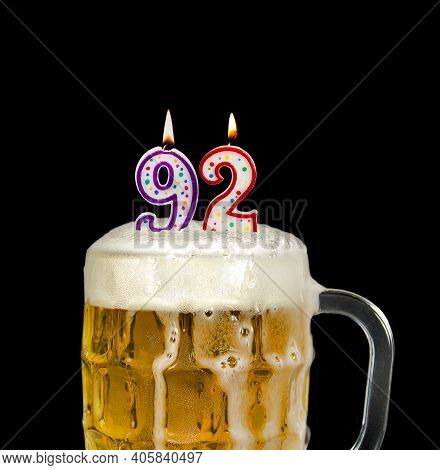 Number 92 Candle In Beer Mug For Birthday Celebration Isolated On Black