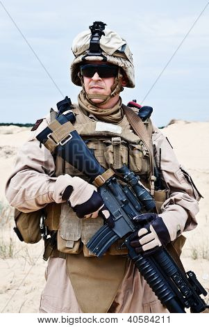 US marine in the MARPAT uniform and protective military eyewear poster