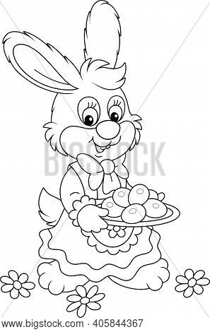 Cute Little Bunny In A Beautiful Holiday Dress Holding A Dish With Chocolate Easter Eggs, Black And