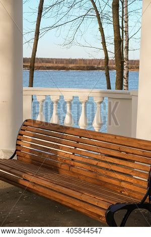 Bench And Winter View Of The Volga Through The Balusters Of The White Gazebo