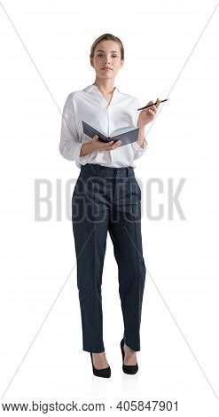 Attractive Young Woman Is Holding A Notebook And Pondering How To Optimize Business Process To Boost