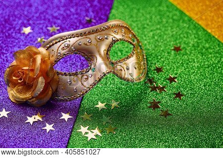 Festive, Colorful Mardi Gras Or Carnivale Mask On Golden, Green And Purple Background. Venetian Mask