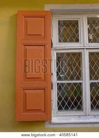 orange blinds on a window
