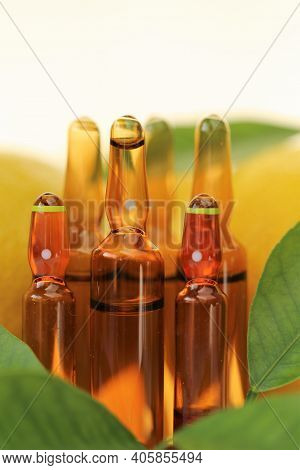 Vitamin C Injection.a Solution Of Vitamin C In Brown Glass Ampoules Set, Lemons . Ampoules And Serum
