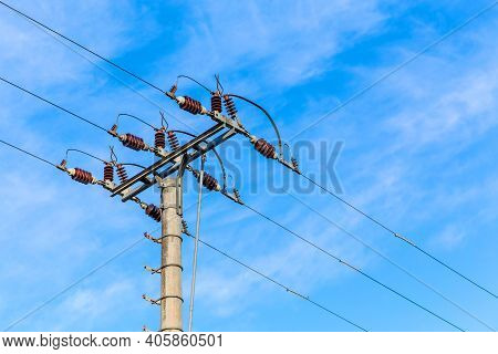 Electricity Distribution In Czech Republic. Electricity Poles In A Row. High Voltage Poles In The Cl