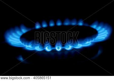 Gas Cooker With Burning Fire Propane Gas. Blue Flames On Gas Stove Burner Isolated On Black Backgrou