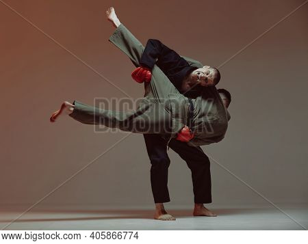 Sparring Of Two Fighting Males In Kimono And Boxing Gloves During Battle, Knockout, Martial Arts, Mi