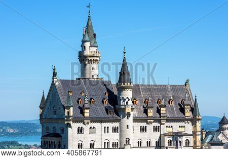 Neuschwanstein Castle Close-up, Germany. Nice View Of Fairytale Castle In Munich Vicinity On Blue Sk