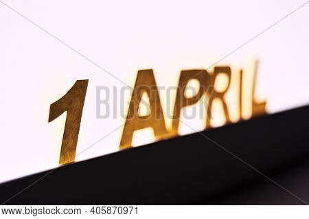 Inscription 1 April Of Yellow Letters On The Background Of A White Led Lamp