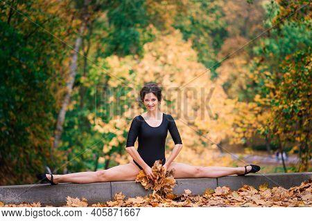 Sexy Brunette Female In Autumn Forest, Public Park. Sport, Slender Body