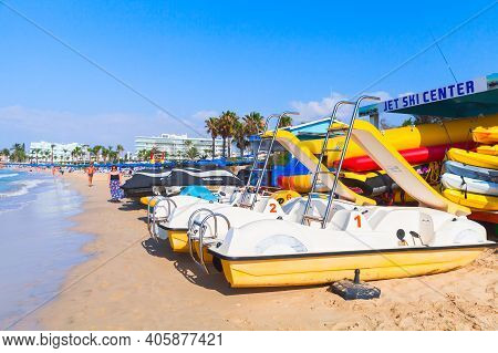 Ayia Napa, Cyprus - June 11, 2018: Pleasure Boats And Walking People At Agia Napa Beach. Resort Town