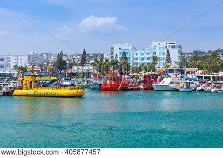 Ayia Napa, Cyprus - June 12, 2018:  Pleasure Boats Moored In Agia Napa, Ordinary People Walk The Coa
