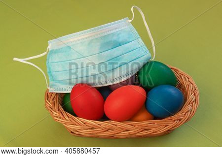Isolated Colored Painted Easter Eggs In Wooden Basket Decoration With Surgical Mask, A Symbol Of Cor