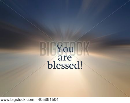 Spiritual Inspirational Words - You Are Blessed. On Blurry Blue Sky And Rushing Clouds Illustration