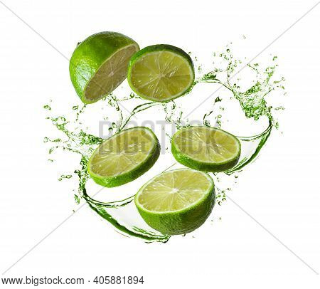 Healthy Food Concept. Juicy Lime. Splashing Water And Crushed Lime In Motion Isolated On White. Halv